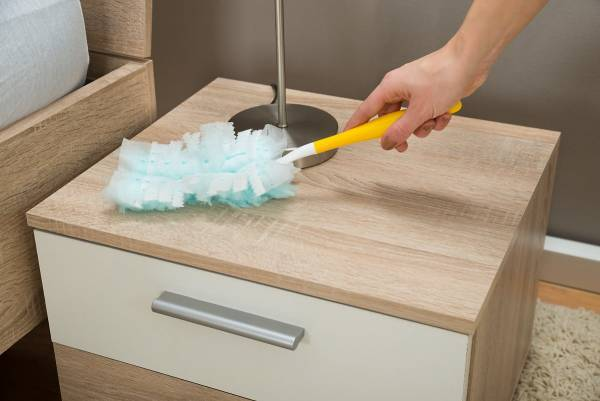 dusting wooden furniture
